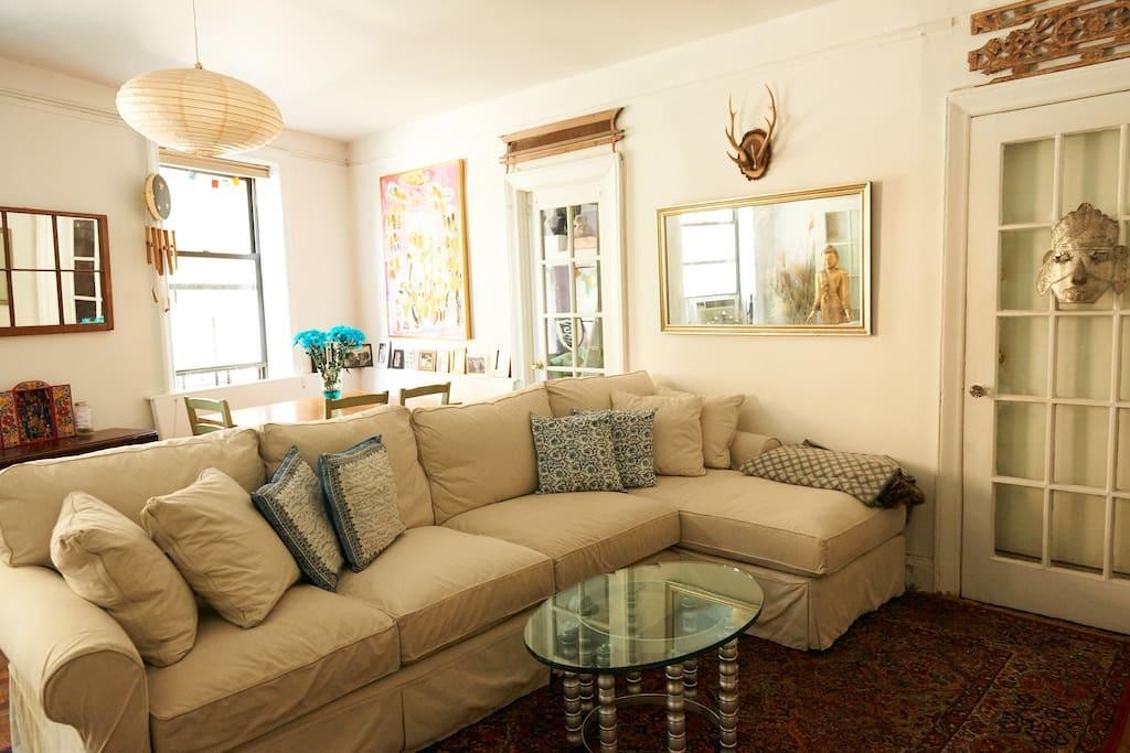 Big comfy couch, flat screen tv with Apple TV, dining nook, AC