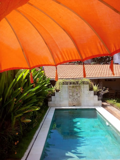 Enjoy The Swimming Pool and the Shadow from a Typical Ceremony Sunbrella...