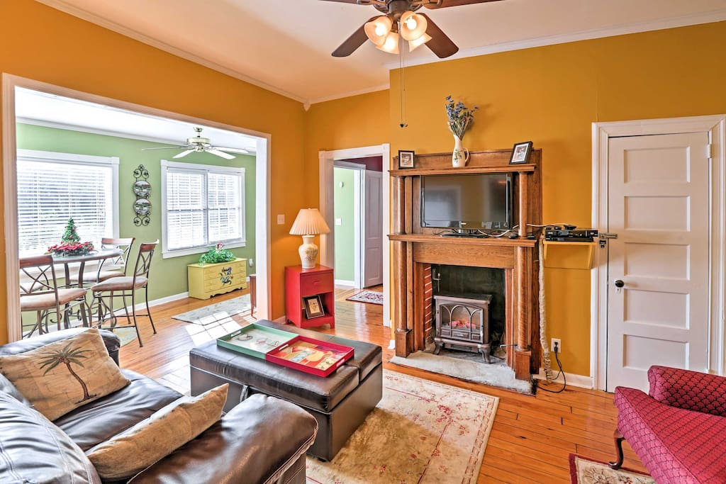 The cozy family room is embellished with gorgeous hardwood floors and a beautiful, old fireplace mantel.