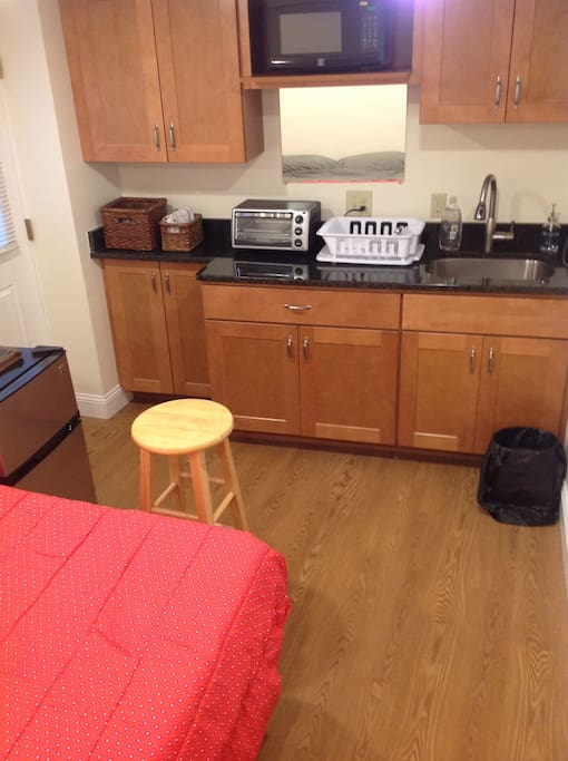 The room is small as there is no desk but has a queen size bed and is perfect for someone just coming to visit.  It is quite functional and nice -the kitchenette features: microwave, hot plate, toaster oven, sink, granite counters and beautiful wooden cabinets.