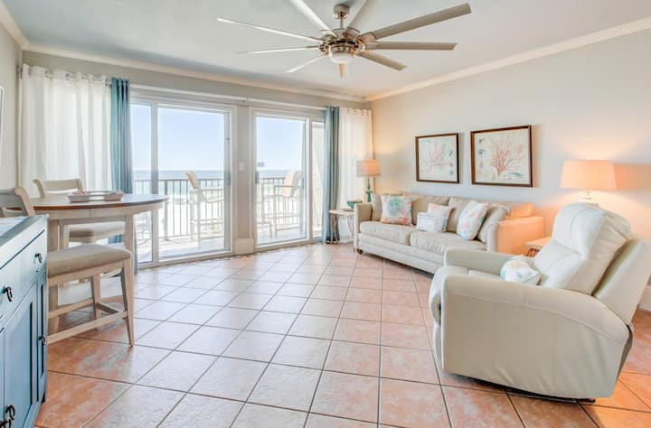 Lovely beachfront condo with water views from private balcony + shared pool!