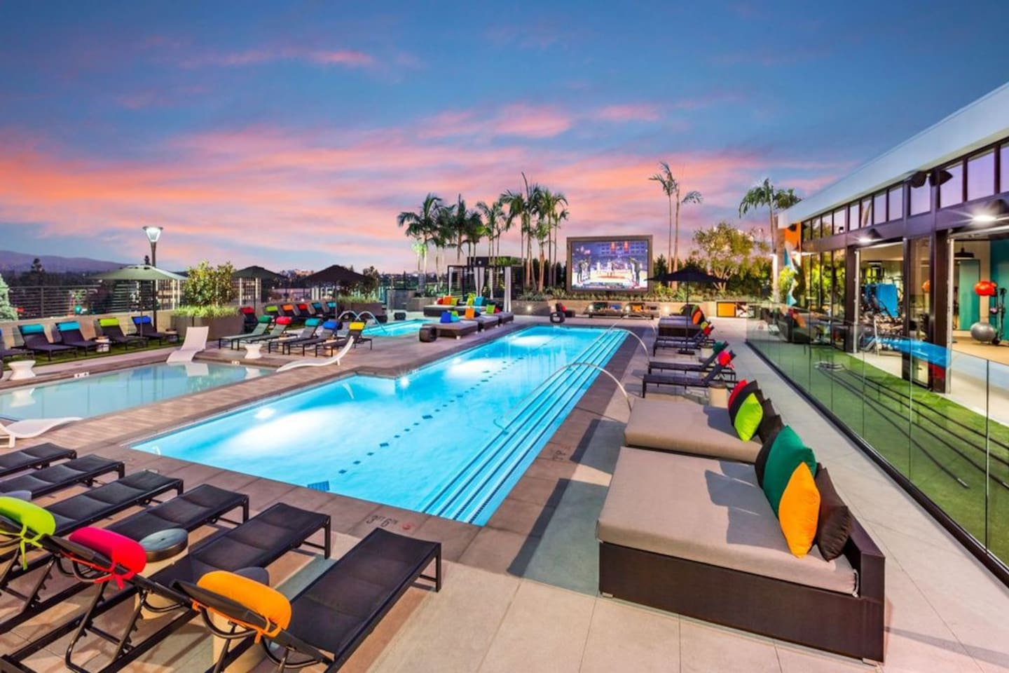 Lay by our massive pool on a rooftop with a giant TV screen and that sweet SoCal sunshine
