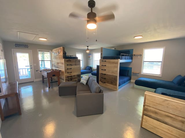 5th bedroom; Bunk room has 2 sets of bunks and 4 platform beds. Will Smart Tv with table under and outlets in place if you want to bring a gaming system. Also adjoining bathroom with shower