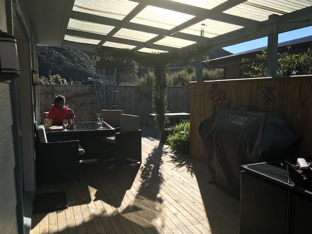 Deck area with BBQ and outside seating