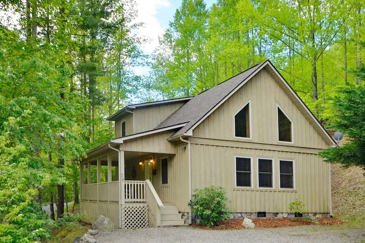Heavily wooded with creek below.  Paved/gated access with gravel parking area.  Cottage is 1 mi from the heart of Maggie Valley.