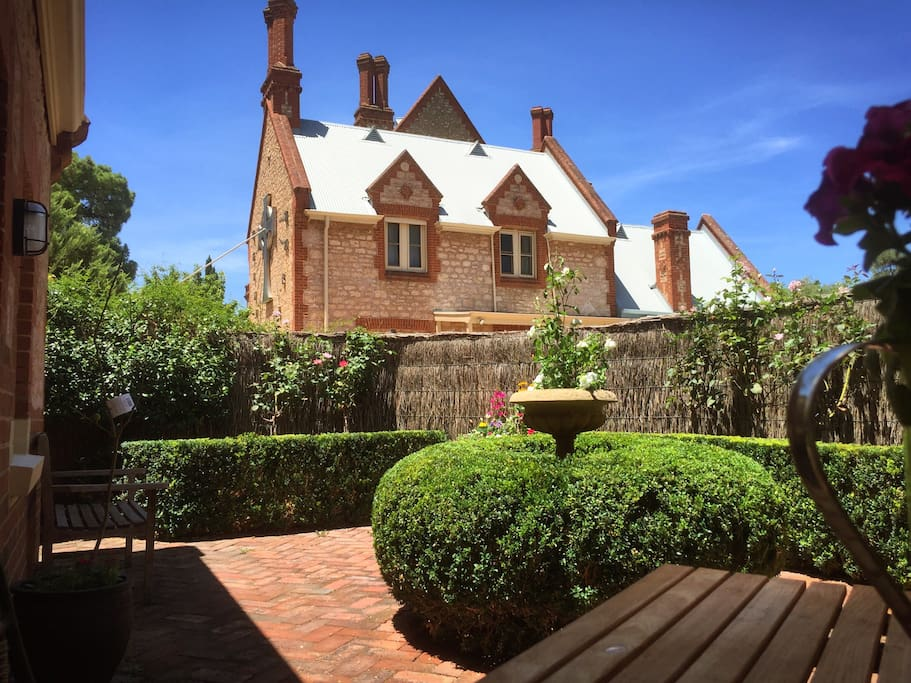 Private entrance and courtyard. Set in the original Bishops Court, the guest room resides just 20min walk to the CBD yet you would think your in the English countryside.