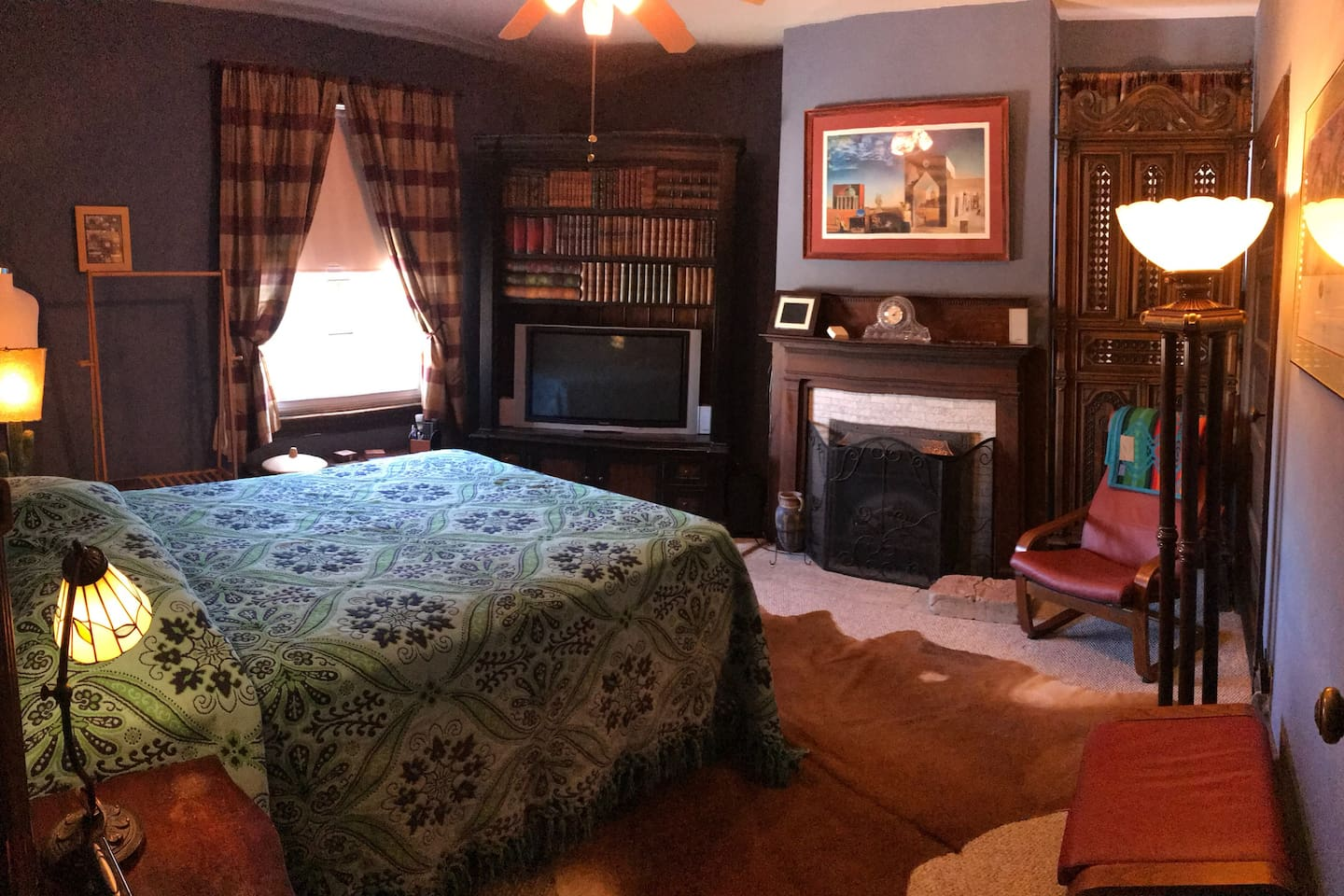 "The ""guest room"" is on the front of the home and is buffered by a private closet area on either side of the bedroom. There are no adjoining walls to the next bedroom. It is decorated to accentuate the period home and has a great view of the surrounding community. It also has an electric fireplace with simulated flames."