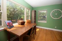 Ample workspace overlooking private wooded backyard.