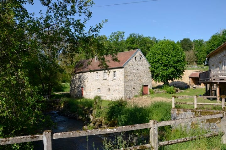 Renovated water mill next to the river Tardes