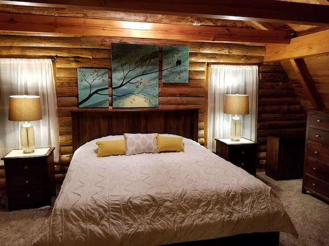 Master bedroom with custom Amish made hard wood furniture.