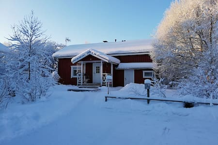 Cosy red house with sauna and fireplace