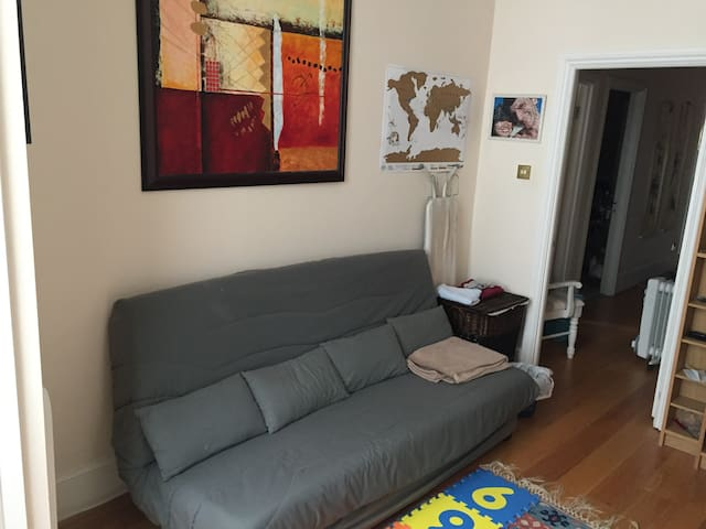 Second bedroom with sofa bed and baby crib