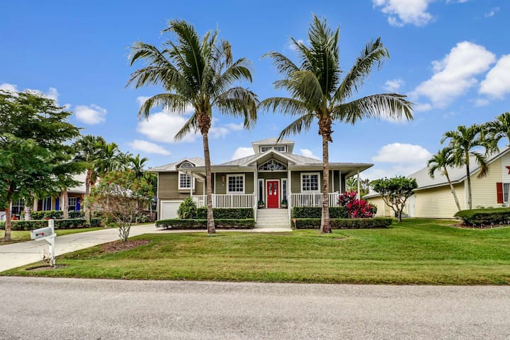 The Old-Florida style home is surrounded by lush, tropical landscaping in a great Bonita Springs neighborhood, close to all SW Florida has to offer!