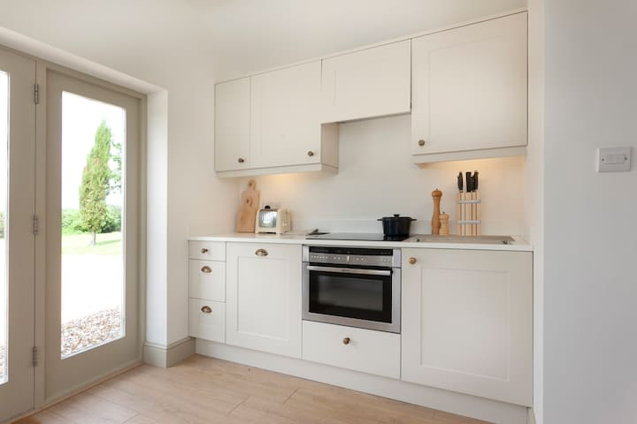 Bespoke well equipped Kitchen with Grade A Neff appliances fridge, oven, induction hob, excellent cookware