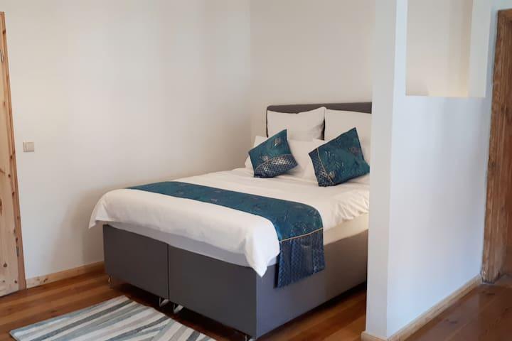Queen bed in Studio 1
