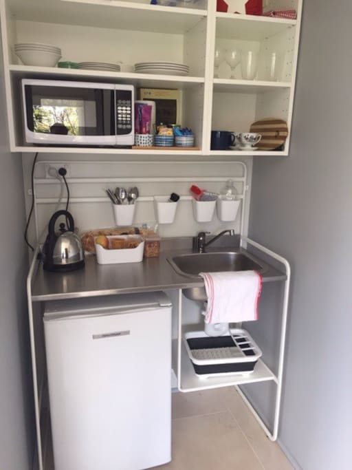 Kitchenette with  fridge, microwave, toaster, kettle, tea and coffee facilities.