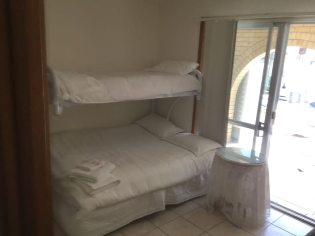 #2 Self Contained Room with Pool onsite
