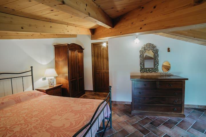 Appartamento Primosole, camera da letto