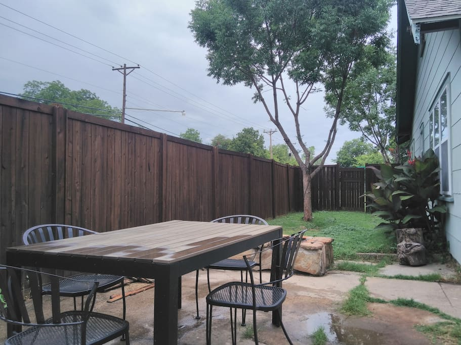 Back yard with fire pit and grill