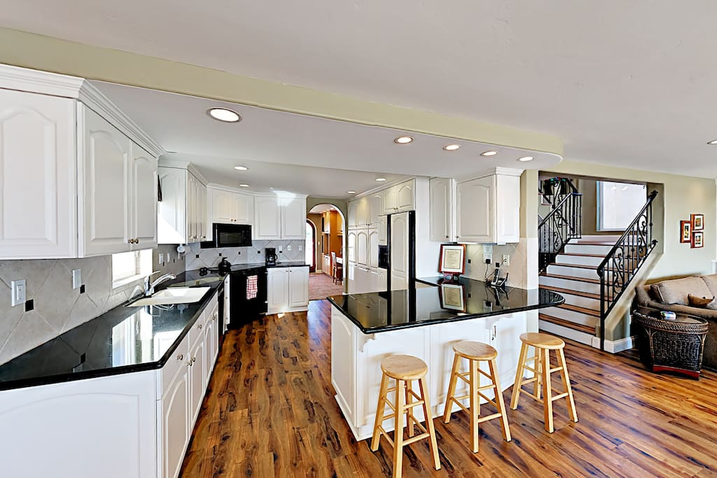 Granite countertops and a large island add to the character of the kitchen.