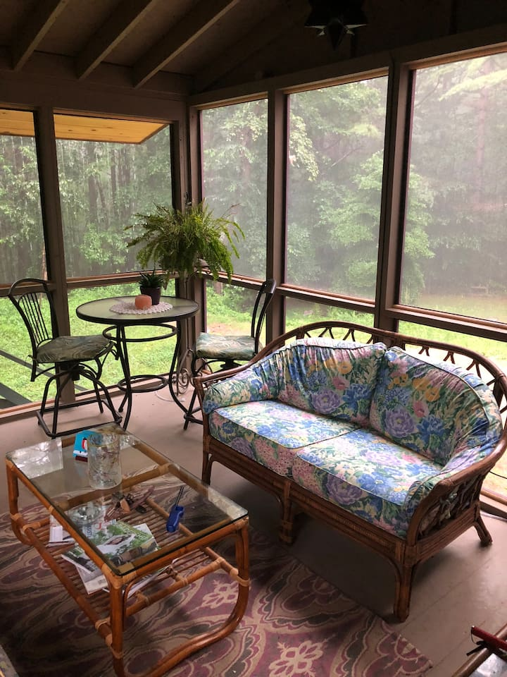 Dine and relax on this beautiful screen porch with the beautiful sounds of nature