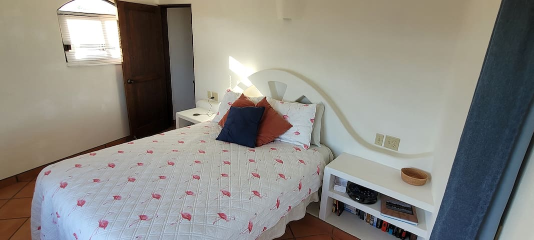 Queen size bed and plenty of storage in this home away from home.