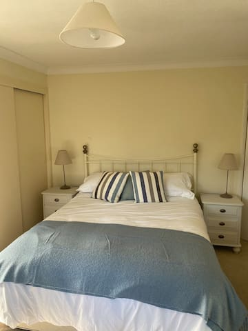 Master bedroom with king size bed and en suite