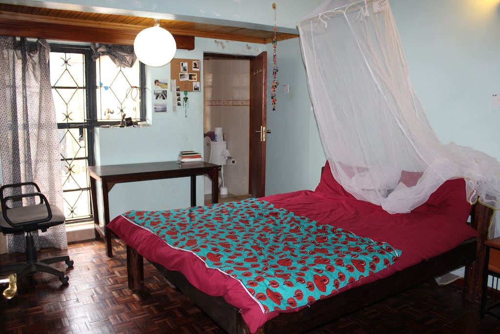 The room, with double bed,closets, balcony and private bathroom