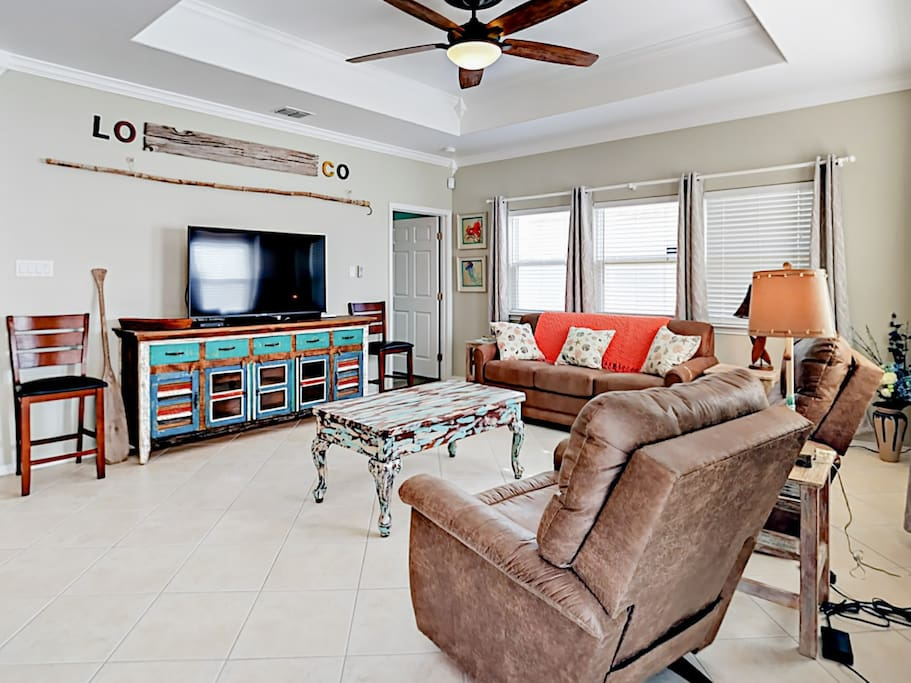 """Claim your spot on the leather sectional or recliner in the living area and enjoy a movie screening on the 65"""" TV."""