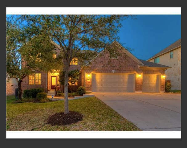 Private family home with 3 car garage & walking distance to a great pool & key access to 3 other pools & lake club