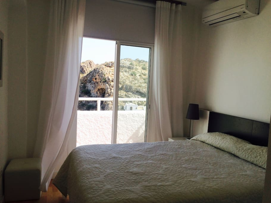 Bedroom 1 with views of the mountain and Mediterranean sea