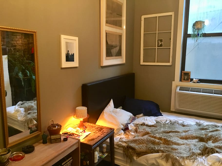 Bed and side table, window opens!