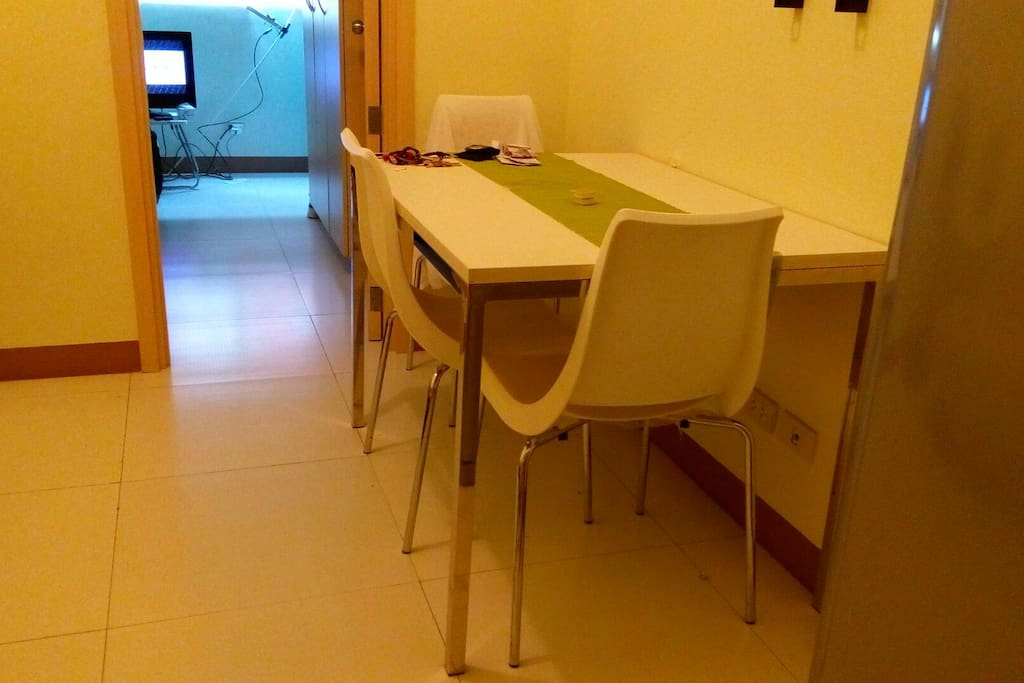 Dining area with use of fridge, microwave and necessary utensils.