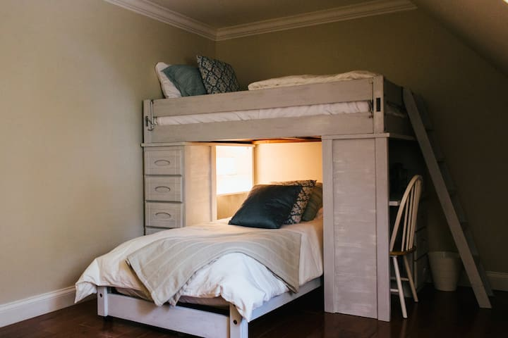 The Blue Room - Features a full sized bed (no longer bunk beds as pictured). It also comes with a couch for additional sleeping space with its own memory foam and an empty closet for your things.
