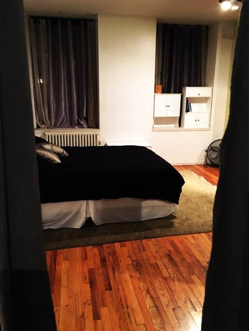 Separate bedroom with queen bed (through the curtains in the other photo)