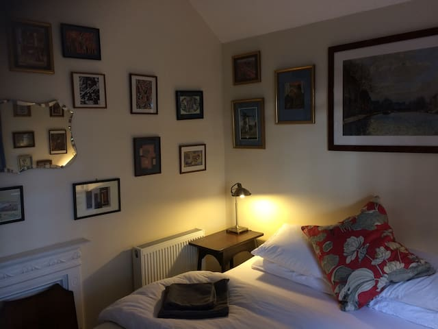 The walls in the guest bedrooms and corridor are full of art