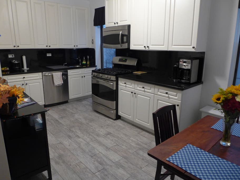 Very large kitchen complete with all culinary necessities.