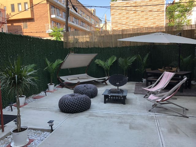 Tropical New Yorker with Backyard