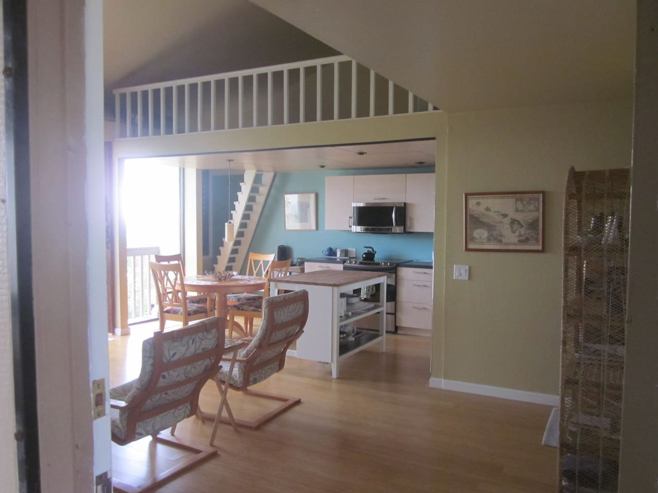 View from front door looking into kitchen with loft above (note ladder-like stairs). We have new furniture - click thru to see all!