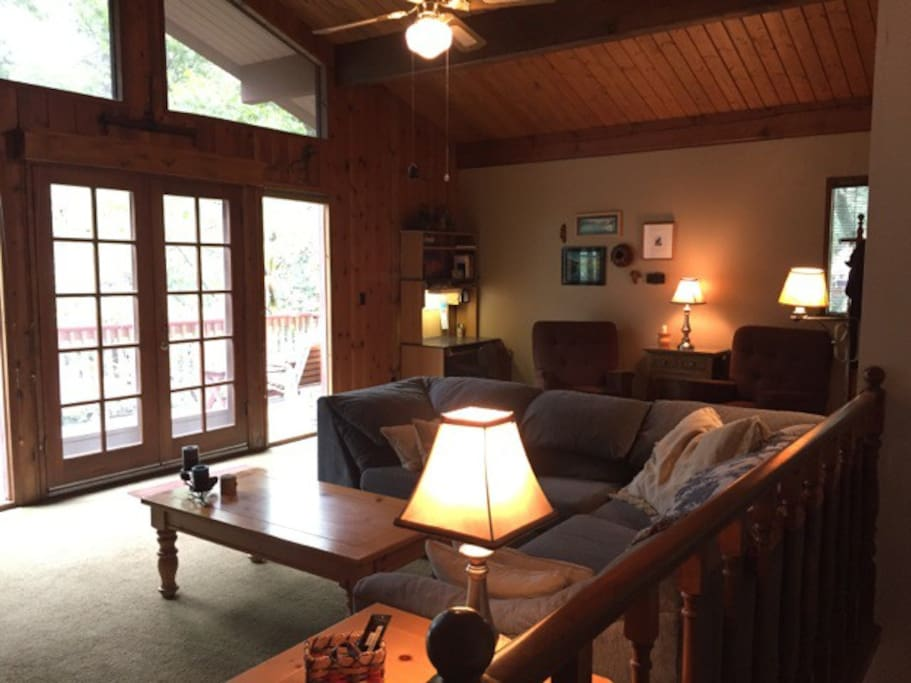 Living Room-French doors lead to back deck where there is a BBQ Grill & seating. The tree view is peaceful and relaxing.