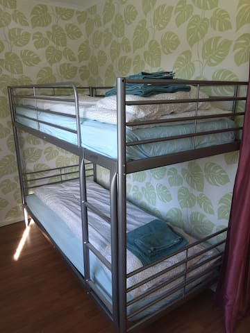 Bedroom 3 with bunk beds, built in wardrobes and large mirror.