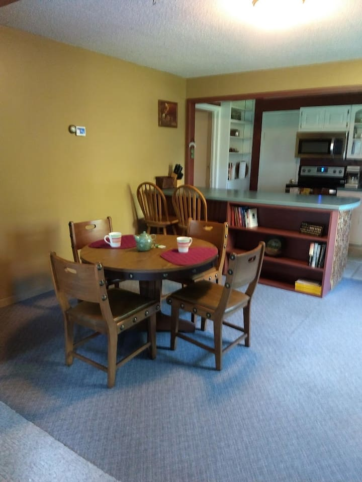 Area for meals and coffee. Kitchen and food prep in background.
