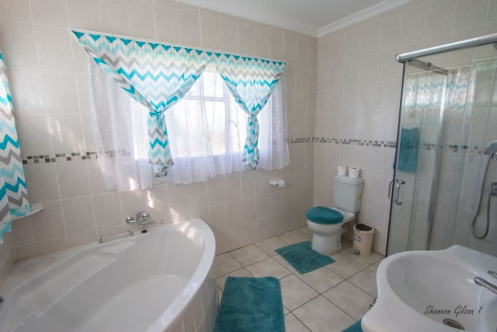 Ensuite Upstairs Bathroom with Shower & Bath