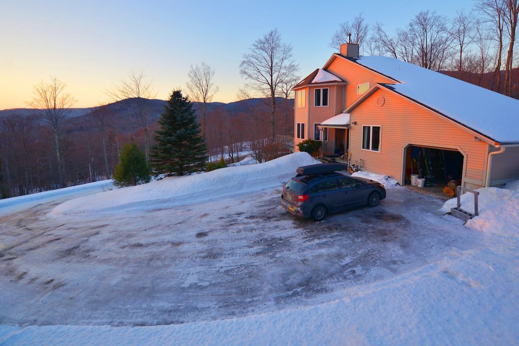 Driveway during sunset. There is level parking lower on the driveway for cars that can't make it all the way up.