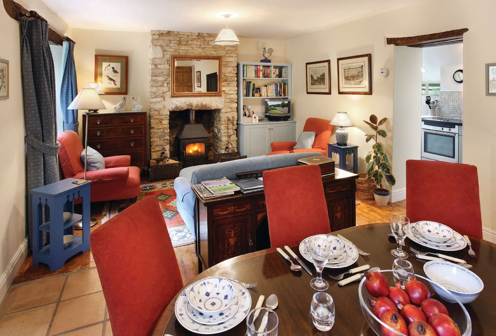Ground floor:  Sitting room with wood burning stove and dining area