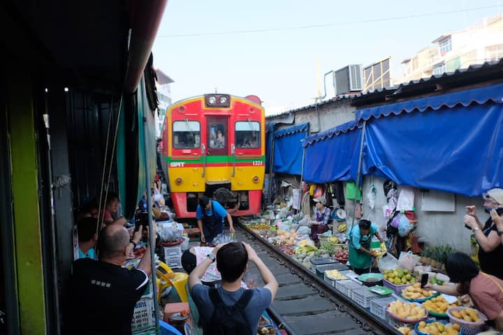 The train passing through the market