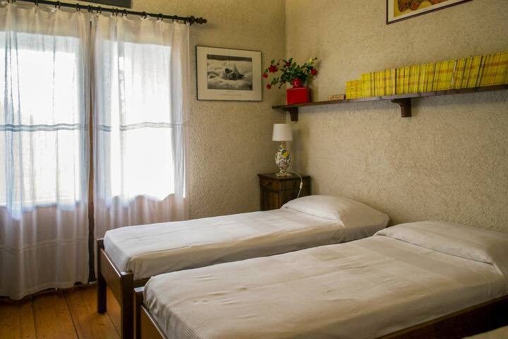 Two single beds on first floor with balcony ( also can be made as double room)