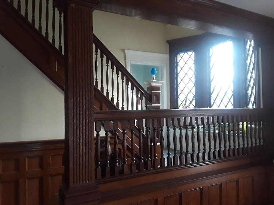 Grand stair case with large bay windows lead to kitchen, guest bedrooms and guest bathroom.