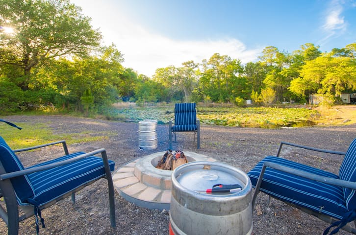 A fire pit with keg end tables.