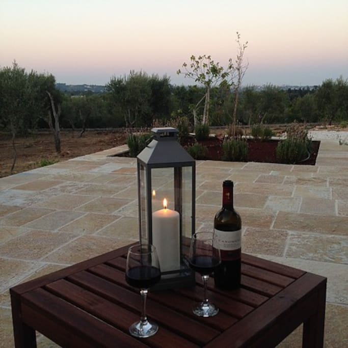 Trullo Lily's panoramic sun terrace at dusk.